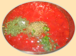 Spices added to pot of canned tomatoes