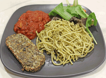 spaghetti served with salad and spaghetti sauce